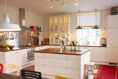 ikea kitchen. white, black and dark grey stone, with wooden floor